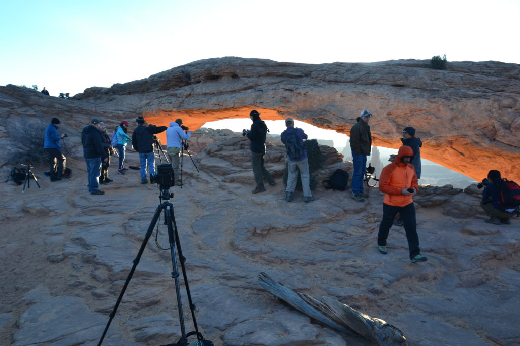 Photographers catching the sunrise at Mesa Arch